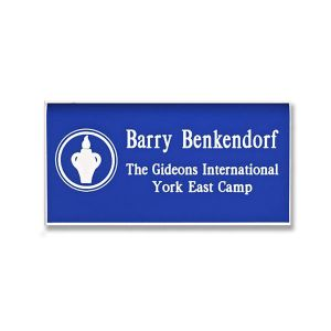 Blue name tag with engraved white Gideons International logo and names and titles.