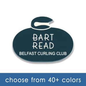 green curling club name tag shaped like curling stone with white engraved text