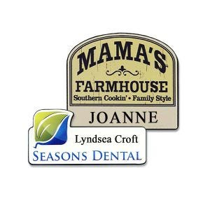 Custom shaped name tag with full color printed logo and engraved text on white and almond colored plastic.