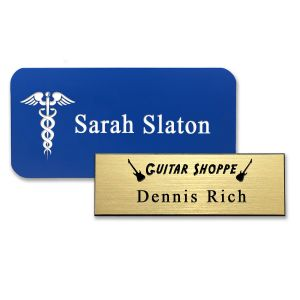 Plastic blue and gold name tags with engraved logos and text.