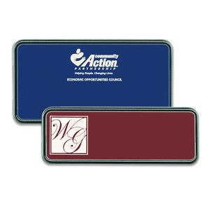Blue and red plastic name tags with silver frames and engraved logos.