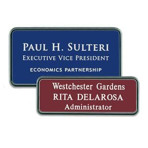 Blue and red plastic name tags with silver frames with engraved text.