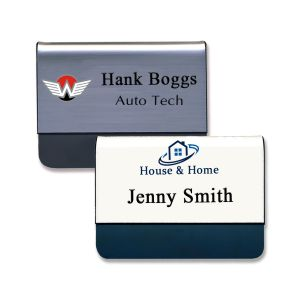 Silver and white pocket name tags with black tongues and engraved text with full color printed logos.