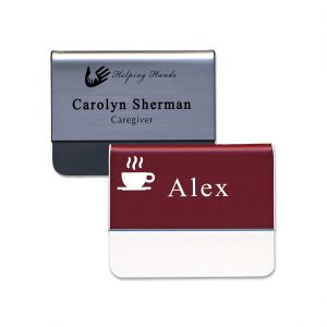 Silver and red plastic pocket name tags with engraved logos and text.