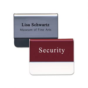 Silver and red plastic pocket name tags with engraved text.