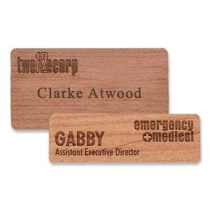 Wooden name tags with engraved logo and text cut from high-quality premium wood.