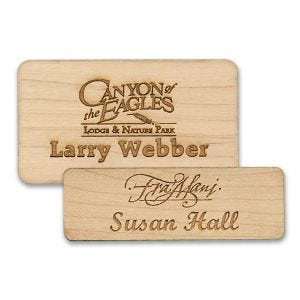 Standard wooden name tags with engraved logo and lines of text on high quality birch wood.