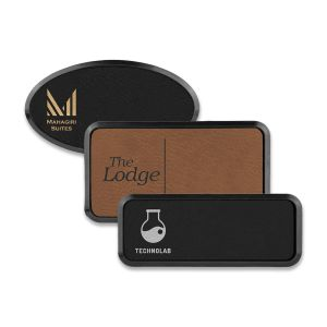 Framed rectangle and oval brown and black leatherette name tags with engraved logos.