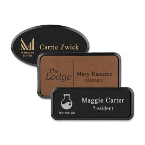 Framed rectangle and oval brown and black leatherette name tags with engraved logo and lines of text
