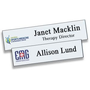 Full Color Printed Name Tags with logo and engraved text lines. White background with black engraved text and full color logos.