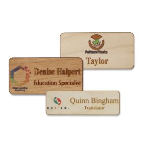 Full color wooden name tags with full color printed logos and engraved names and text on fine-grain wood.