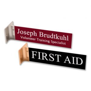 double-sided black and red corridor sign with white engraved text on both sides & gold & silver mounting bracket