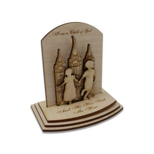 """Laser-engraved 3-D birch wood LDS temple puzzle featuring the words """"I Love To See The Temple"""" & inset of small children in front of the temple"""