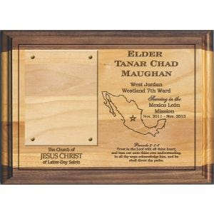 "laser engraved lds missionary plaque on solid alder wood with dark accents at top & bottom, featuring missionary's name, dates of service, mission boundaries, favorite scripture passage, and a clear window for inserting a 3.5"" x 2"" photo"