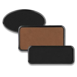 Framed rectangle and oval brown and black leatherette name tags blank.