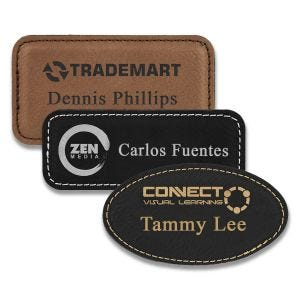 Rectangle brown and black leather name tags with engraved logo and lines of text