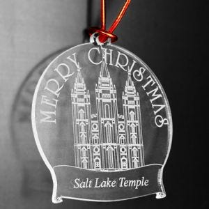 100 percent acrylic Christmas ornament with engraved temple and the words Merry Christmas
