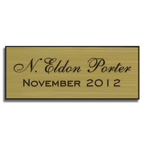 gold perpetual plaque insert with black text and double-sided mounting tape on back