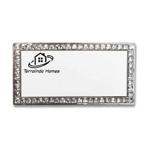 Rhinestone bordered name tag with printed company logo.