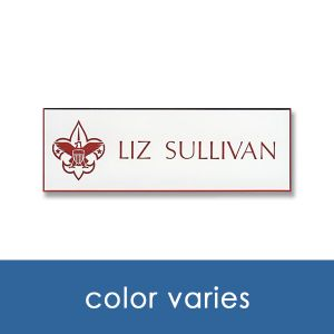 White name tag with red engraved Scouting logo and names and titles.