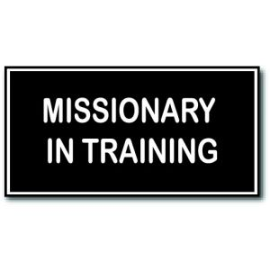 small rectangle imitation LDS missionary tag, black background with the words Missionary In Training engraved in white