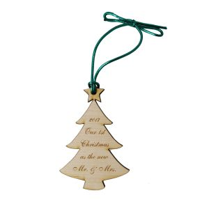 Birch wooden Christmas tree ornament with customized engraved text phrase and tied with green metallic cord for hanging.